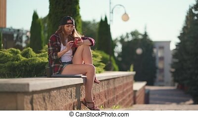 College student using smartphone at campus. Beautiful Young ...
