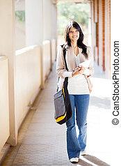 college student walking down school corridor