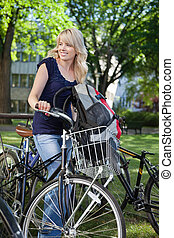 College Student with Bike - Beautiful blonde female student...