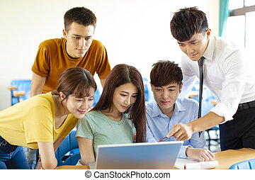 college students and teacher discussing ideas in classroom