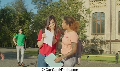 College students consoling friend after failed exam