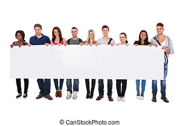 College Students Displaying Blank Billboard - Full length...