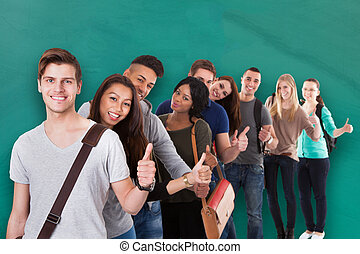 College Students Gesturing Thumbs Up In A Line