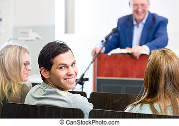 College students in lecture with professor - Students...