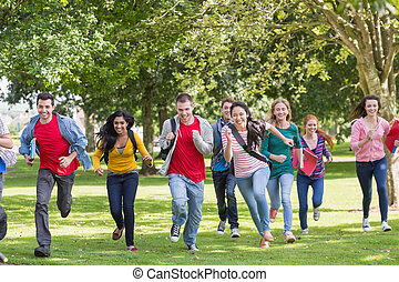 College students running in the park - Full length of a...