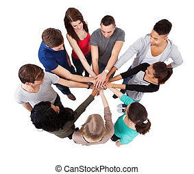 College Students Standing Hands Against White Background