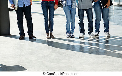 College Students Standing In A Row On University Campus