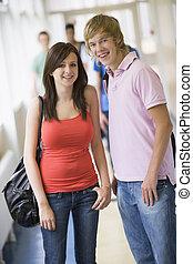 College students standing in university corridor