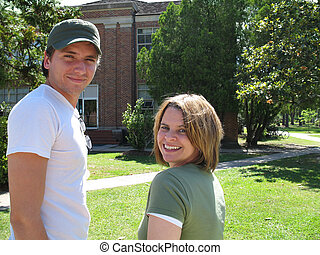 two smiling college students on campus