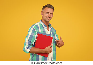 College university education. Man adult student. Final exam and graduation. Dedicated to studying. Student with textbooks. Regular student carry workbooks. Student life. Keep learning all life