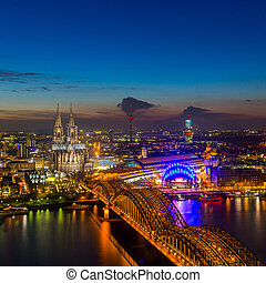 Cologne Cathedral and bridge at sunset