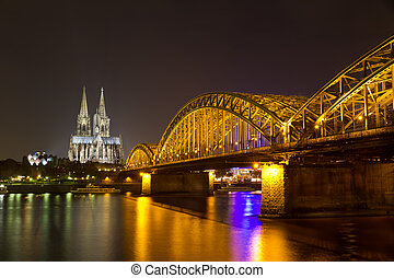 Cologne Cathedral and Hohenzollern Bridge at night, Cologne (Koeln), Germany