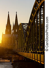 Cologne Cathedral and Hohenzollern Bridge at sunset