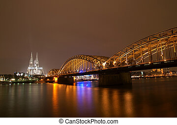 Cologne cathedral with Hohenzollern bridge at night