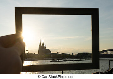 Cologne cityscape and landscape and skyline during sunset trough a picture frame
