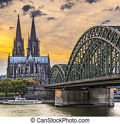 Cologne, Germany at the cathedral and bridge over the Rhine...