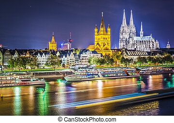 Cologne, Germany cityscape over the Rhine River.