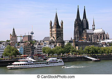 Cologne, Germany - cityscape with Rhine river and famous cathedral. Photo may seem tilted to the left - optical illusion.