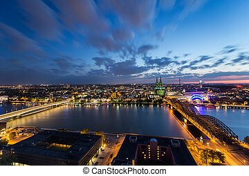 cologne skyline aerial view at night with cloudy sky