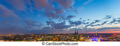 Cologne skyline at sunset with cloudy sky