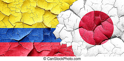 Colombia flag with Japan flag on a grunge cracked wall