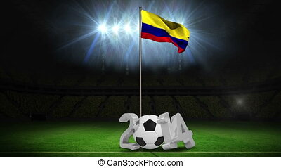Colombia national flag waving on pole with 2014 message on football pitch
