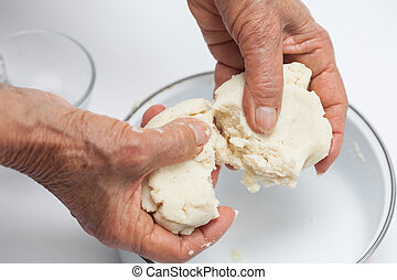 Colombian arepa preparation: Dividing arepa dough into portions