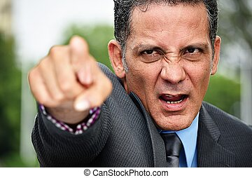 Colombian Business Executive Pointing Wearing Suit
