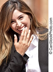 Colombian Business Woman Laughing Wearing Suit