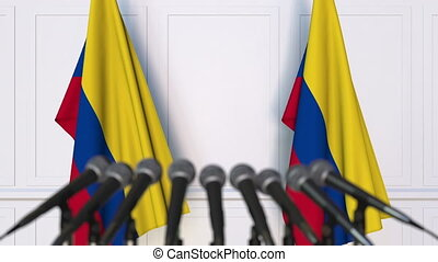 Colombian official press conference. Flags of Colombia and...