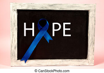 Colon cancer awareness poster. Blue ribbon made of dots on white background. Medical concept.