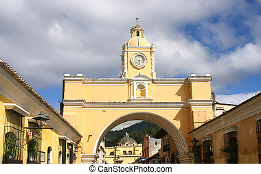 Colonial arch - Yellow arch in old capital of Guatemala over...