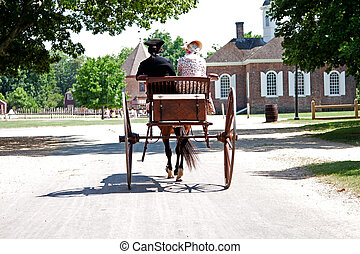 Colonial horse carriage with couple - Rear view of a...