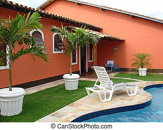 Colonial red house with swimming pool