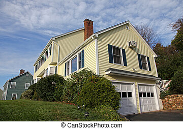 Colonial style home - Yellow New England Style colonial...