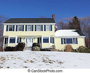 Colonial style house in winter - Traditional American...