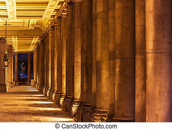 Colonnade in University of Greenwich, London at night
