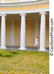 colonnade - young woman in white dress against antique...