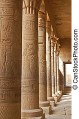 Colonnade with Egyptian carving in Philae temple, Egypt