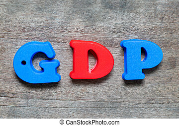 Color alphabet in word GDP (Abbreviation of good distribution practice or gross domestic product) on wood background