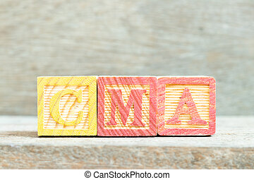 Color alphabet letter block in word CMA (Abbreviation of Certified management accountant,Competition and markets authority or Certified medical assistant) on wood background
