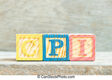 Color alphabet letter block in word CPI (abbreviation of Consumer Price Index) on wood background