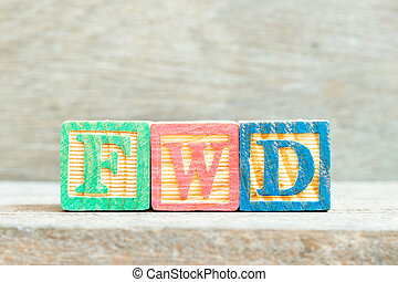 Color alphabet letter block in word FWD (Abbreviation of forward)  on wood background