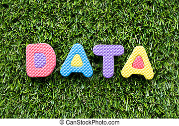 Color alphabet letter in word data on artificial green grass background