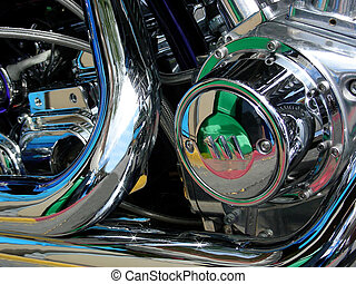 Color reflection in chrome pipes and engine of a hot motorcycle