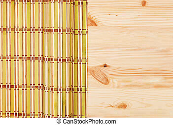 Color bamboo mat on wooden table