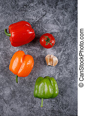 Color bell peppers on a blue background. Top view.