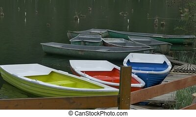 Color Boats Moored at Wharf - Color boats gentle waving on...
