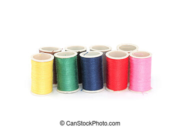 Color bobbins of thread on white background