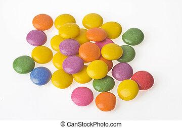 color bonbons on white background